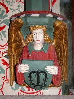 Angel with symbol M
