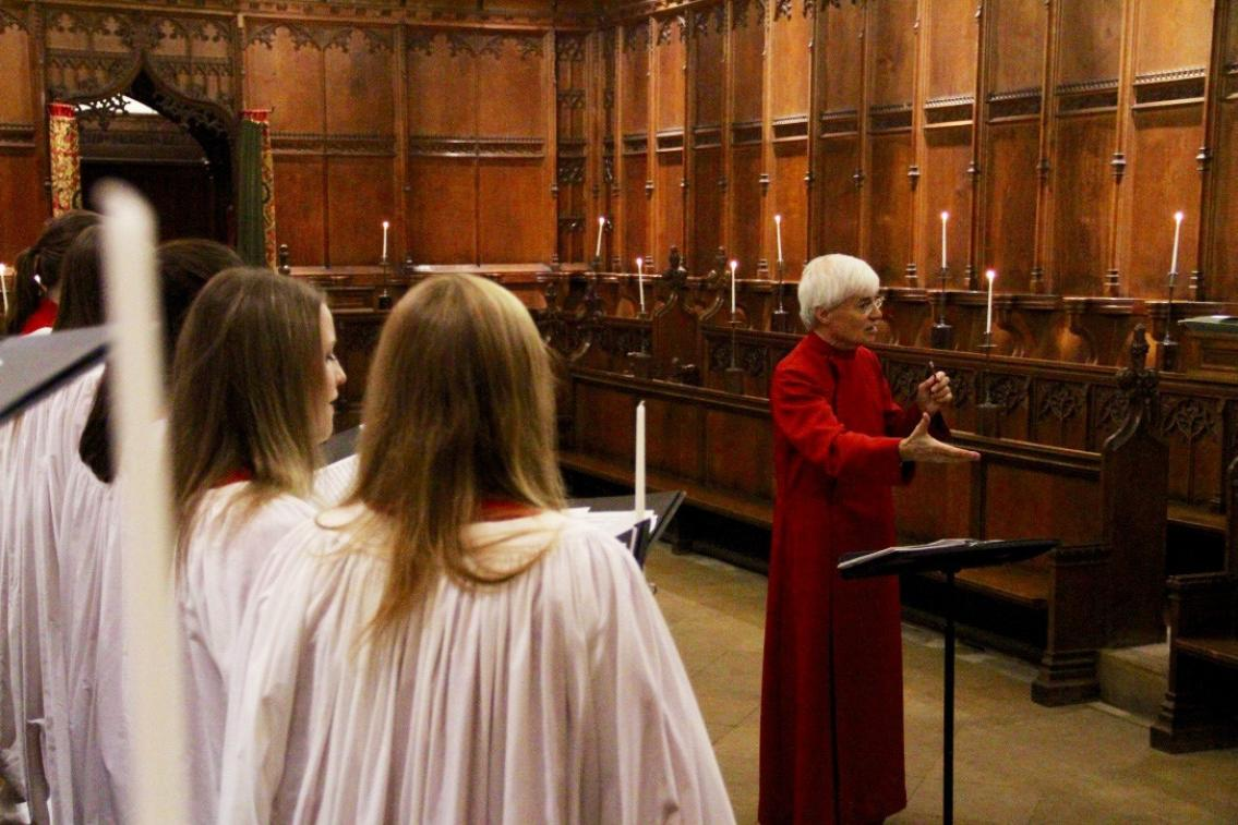A photograph of the choir and conductor.