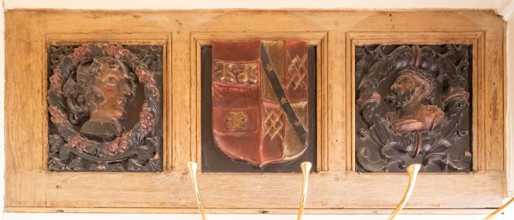 Photo of three carved panels