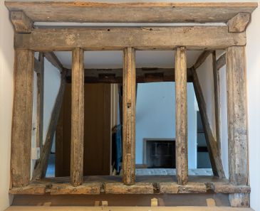 Photo of old attic window enclosed by Long Gallery