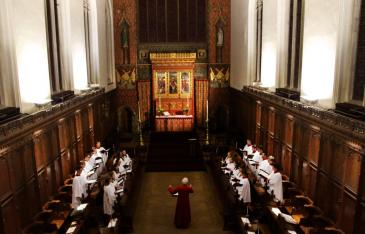 A photograph of the choir in the Queens' College chapel.