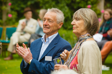 A photograph of guests at the Queens' Annual Garden Party.