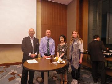 A photograph of alumni at a Queens' Global event.