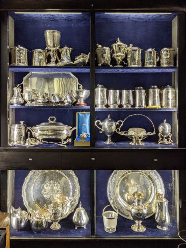 Photo of college silver on display