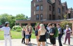 Photo of a student and visitors at an open day